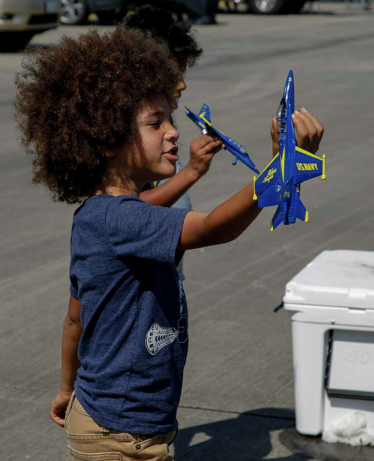 Gideon Thomson, 5, plays with a toy airplane while attending this year's Wings Over Houston airshow at Ellington Airport on Saturday, Oct. 10, 2020, in Houston.