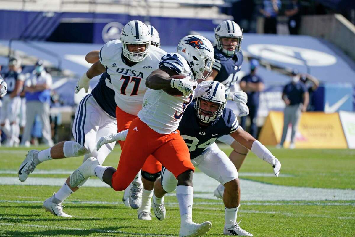UTSA running back Sincere McCormick (3) carries the ball as BYU linebacker Kavika Fonua (34) moves in for a tackle in the first half during an NCAA college football game Saturday, Oct. 10, 2020, in Provo, Utah. (AP Photo/Rick Bowmer, Pool)