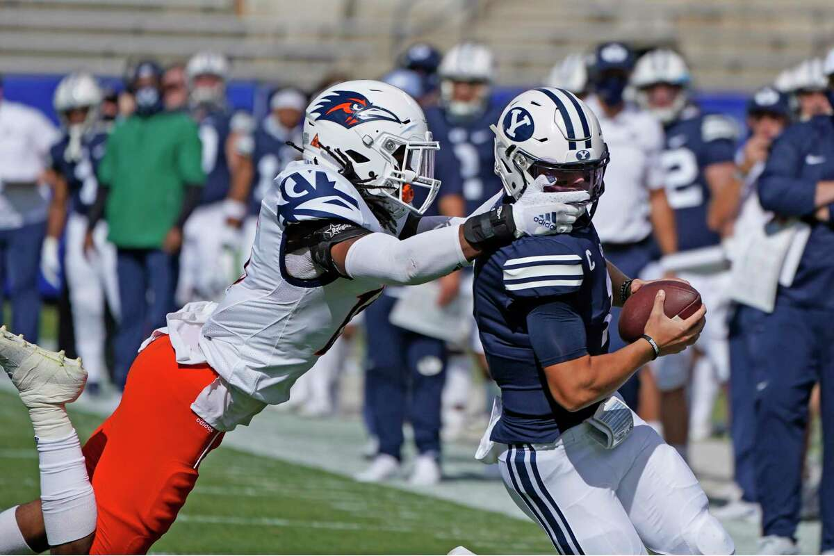 UTSA linebacker Trevor Harmanson, left, grabs the face mask of BYU quarterback Zach Wilson in the first half during an NCAA college football game Saturday, Oct. 10, 2020, in Provo, Utah. (AP Photo/Rick Bowmer, Pool)