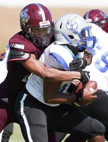 Heights defensive lineman Darius Cleveland, left, sacks Westbury quarterback Jeremiah Randolph during the second half of a high school football game, Saturday, Oct. 10, 2020, in Houston. Photo: Eric Christian Smith, Contributor / Houston Chronicle