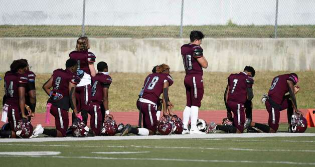 Members of the Heights Bulldogs stand and kneel during the national anthem before a high school football game against Westbury, Saturday, Oct. 10, 2020, in Houston. Photo: Eric Christian Smith, Contributor / Houston Chronicle