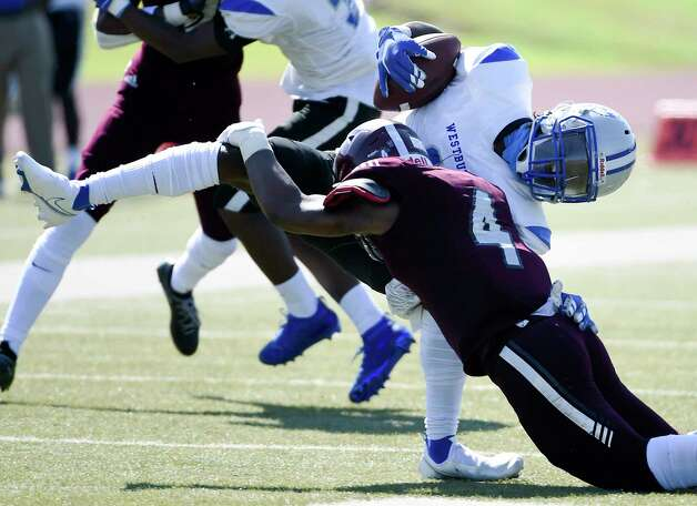 Westbury wide receiver Pierre Emva-Wilson, top, is tackled by Westbury defensive back Sy Johnson (4) during the first half of a high school football game, Saturday, Oct. 10, 2020, in Houston. Photo: Eric Christian Smith, Contributor / Houston Chronicle
