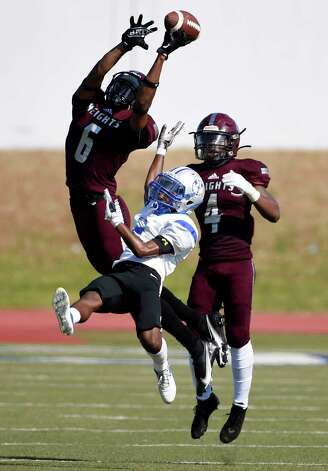 Heights defensive back Chris Smith (6) misses an interception chance on a pass intended for Westbury wide receiver Terry Frazier, center, during the first half of a high school football game, Saturday, Oct. 10, 2020, in Houston. Photo: Eric Christian Smith, Contributor / Houston Chronicle