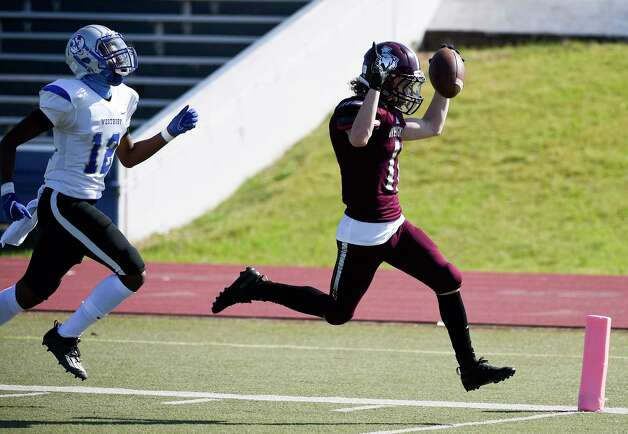Heights wide receiver Kenneth Booth, right, signals touchdown as he runs into the end zone past Westbury defensive back Xavier Lewis for a touchdown during the first half of a high school football game, Saturday, Oct. 10, 2020, in Houston. Photo: Eric Christian Smith, Contributor / Houston Chronicle