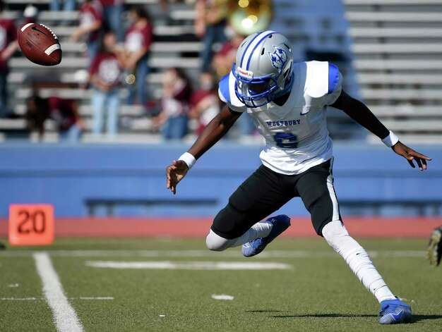 Westbury quarterback Ntakirutimana Ettiene chases a high snap during the first half of a high school football game against Heights, Saturday, Oct. 10, 2020, in Houston. Photo: Eric Christian Smith, Contributor / Houston Chronicle