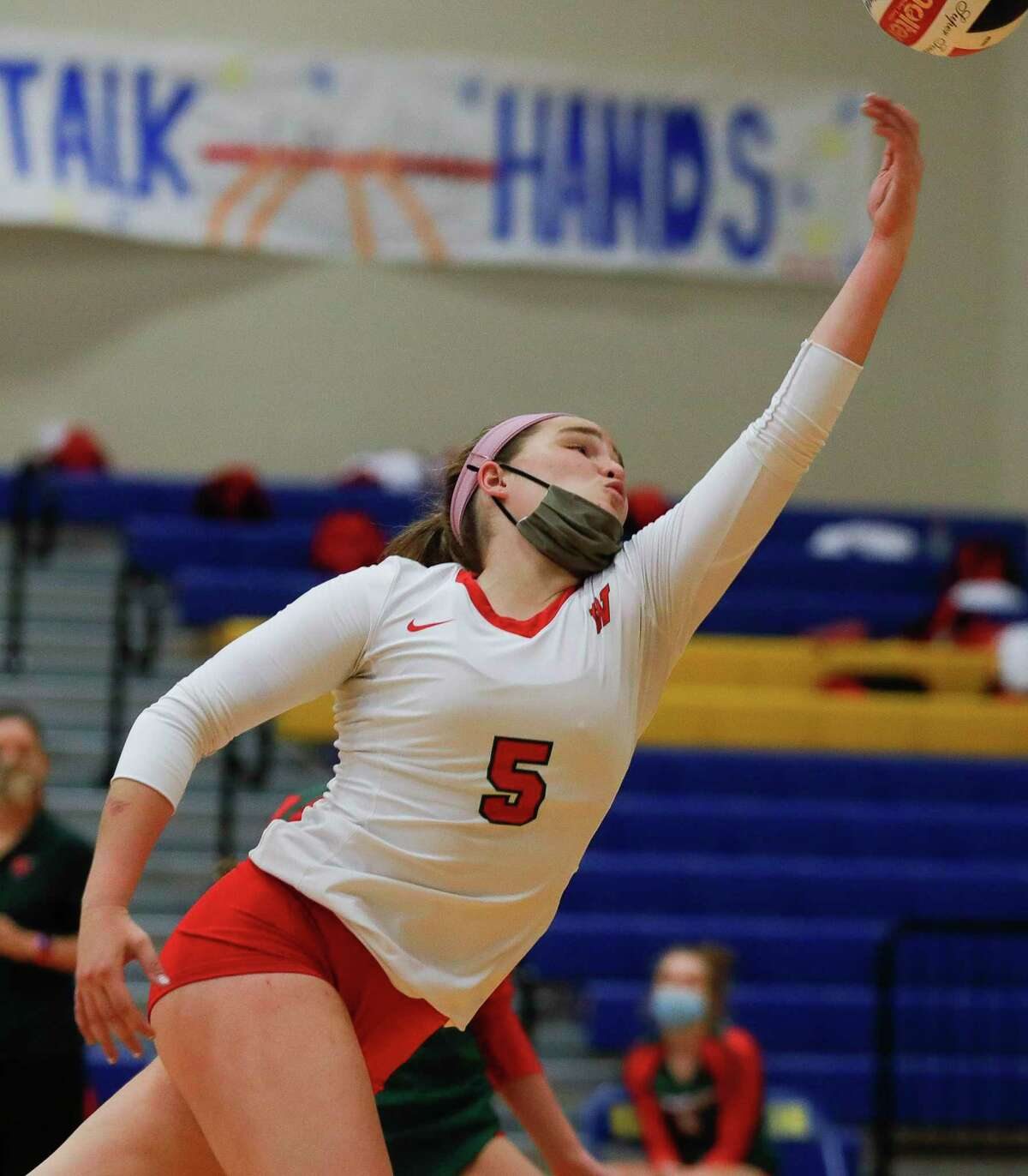 The Woodlands libero Jacqueline Lee (5) tries to save the ball during the first set of a non-district high school volleyball match at Klein High School, Saturday, Oct. 10, 2020, in Spring.
