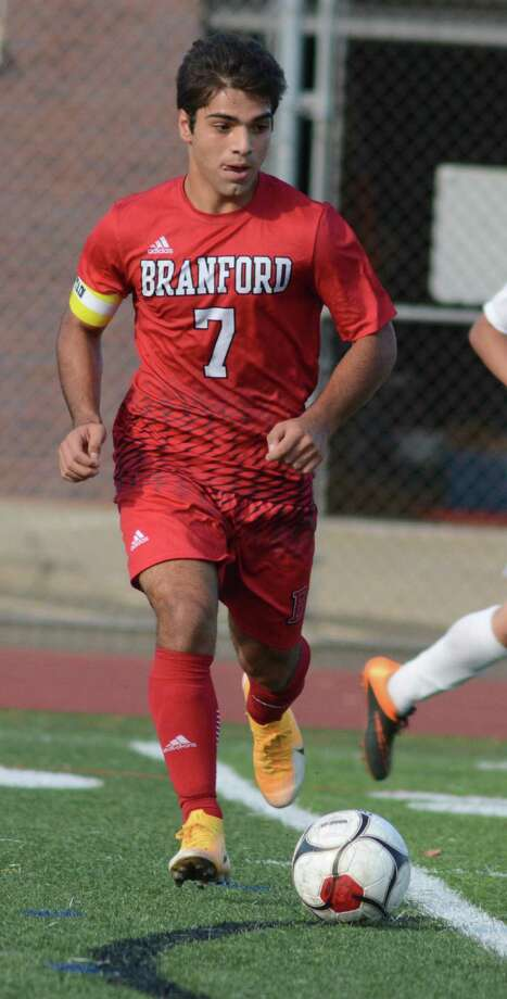 Branford's Raffaele Ciarleglio controls the ball against East Haven on Saturday. Photo: Dave Phillips / For Hearst Connecticut Media