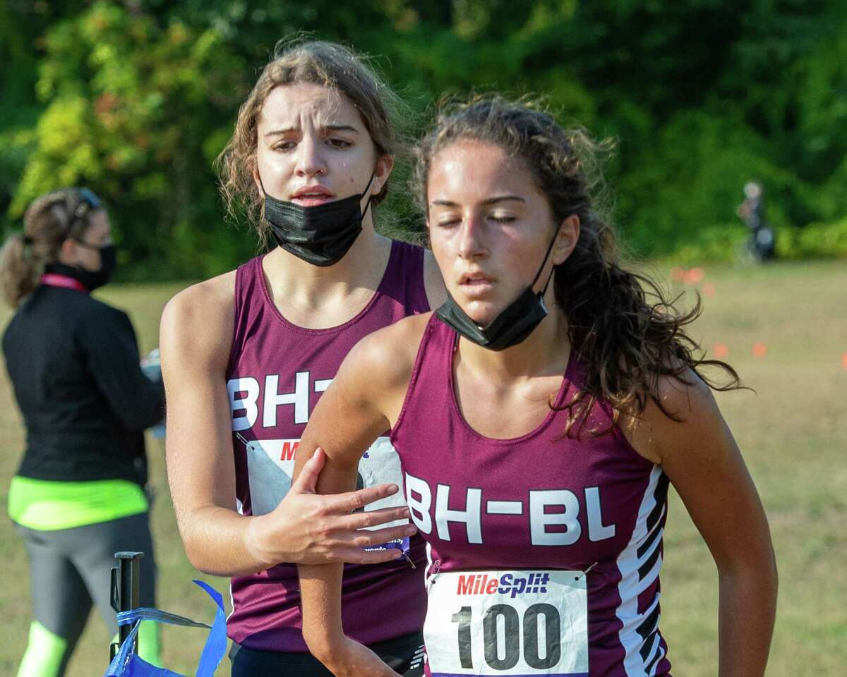 Burnt Hills Ballston Lake runners Jamisen Vendetti and Isabel Vogel cross the finish line in a race against Shaker High School at the Crossings in Colonie, NY, on Saturday, Oct. 10, 2020 (Jim Franco, special to the Times Union.)