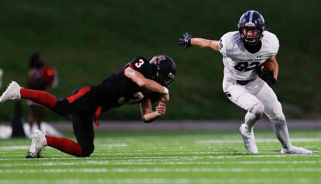 College Park wide receiver Carson Nolen (82) breaks a tackle by Fort Bend Austin linebacker Luke Weaver (3) during the second quarter of a non-district high school football game at Edward Mercer Stadium, Saturday, Oct. 10, 2020, in Sugar Land. Photo: Jason Fochtman, Staff Photographer / 2020 © Houston Chronicle