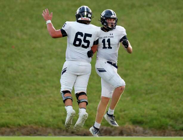 College Park tight end Cody Mladenka (11) celebrates with offensive linemen Grayson Brautigam (65) after catching a 6-yard touchdown pass from quarterback Hank Hudson during the second quarter of a non-district high school football game at Edward Mercer Stadium, Saturday, Oct. 10, 2020, in Sugar Land. Photo: Jason Fochtman, Staff Photographer / 2020 © Houston Chronicle