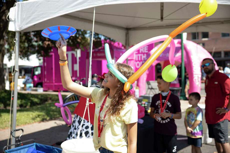 Aaliyah Willis, 14, plays with a spinning disk during the Conroe Cajun Catfish Festival on Saturdayin downtown Conroe. Attendance is expected to be greater than previous years according to the Friends of Conroe. Photo: Gustavo Huerta, Houston Chronicle / Staff Photographer / 2020 © Houston Chronicle