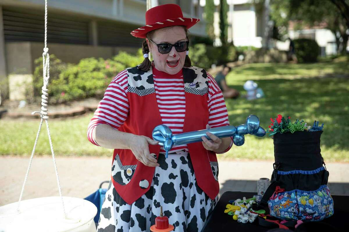 Bucky Lou makes animal balloons during the Conroe Cajun Catfish Festival on Saturday.