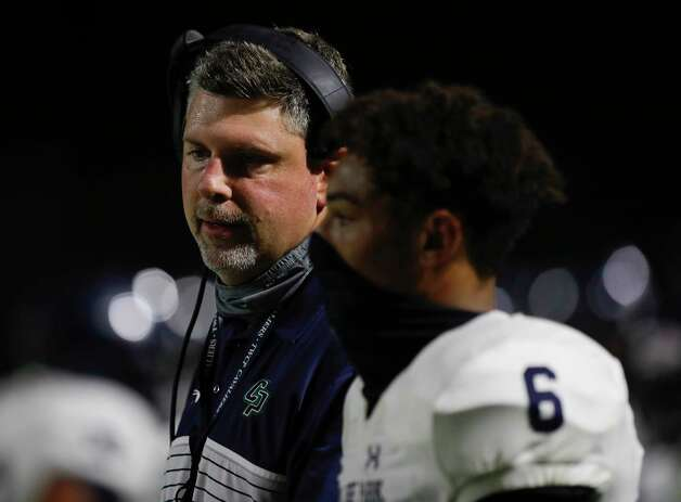 College Park head coach Lonnie Madison talks with quarterback Ty Buckmon during the third quarter of a non-district high school football game at Edward Mercer Stadium, Saturday, Oct. 10, 2020, in Sugar Land. Photo: Jason Fochtman, Staff Photographer / 2020 © Houston Chronicle