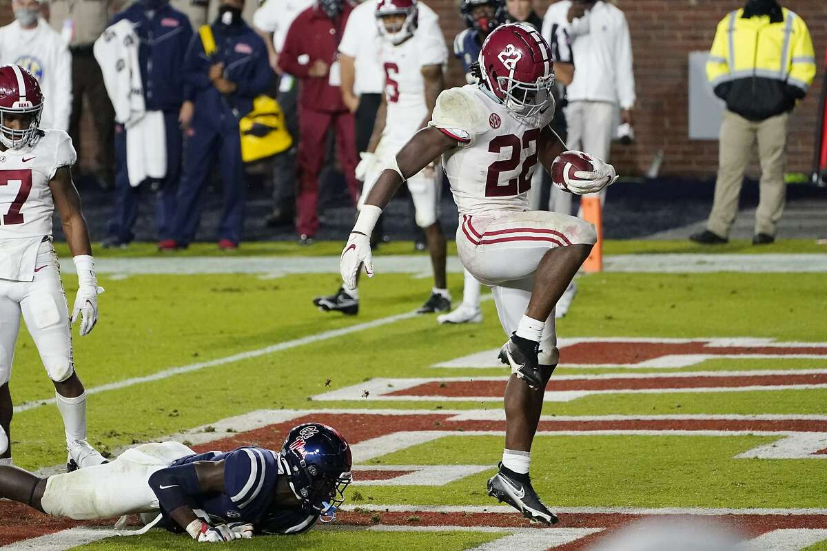 Alabama running back Najee Harris (22) dances after scoring one of his five touchdowns in the Crimson Tide's 63-48 win. Harris, an Antioch High alum, rushed for 206 yards on 23 carries.