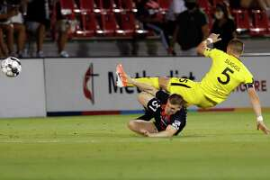 San Antonio FC's Connor Maloney, bottom, takes out New Mexico United's Josh Suggs on a slide tackle Saturday at Toyota Field. San Antonio FC finishes its season with a 10-4-3 record.