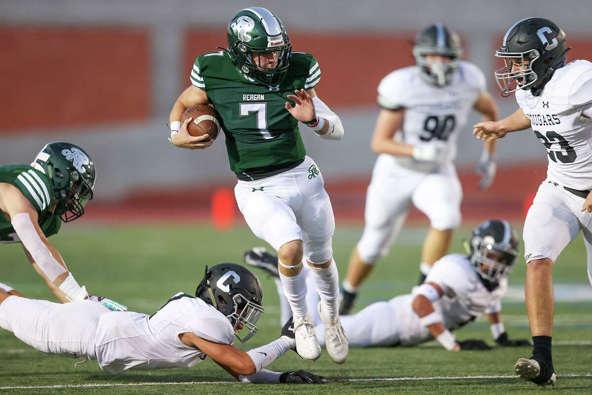 Reagan quarterback Britton Moore, center, races through the Clark defense for a 47-yard touchdown during the first half of their District 28-6A high school football game at Heroes Stadium on Saturday, Oct. 10, 2020.