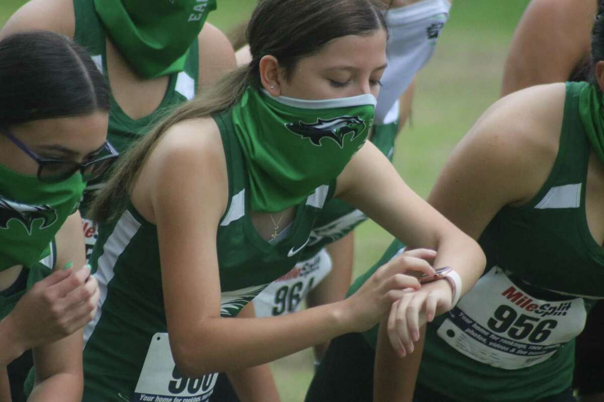 Pasadena High School sophomore Emily Contreras gets ready to start her watch as she prepares to leave the Crenshaw Park starting line for the Red Division varsity girls race.