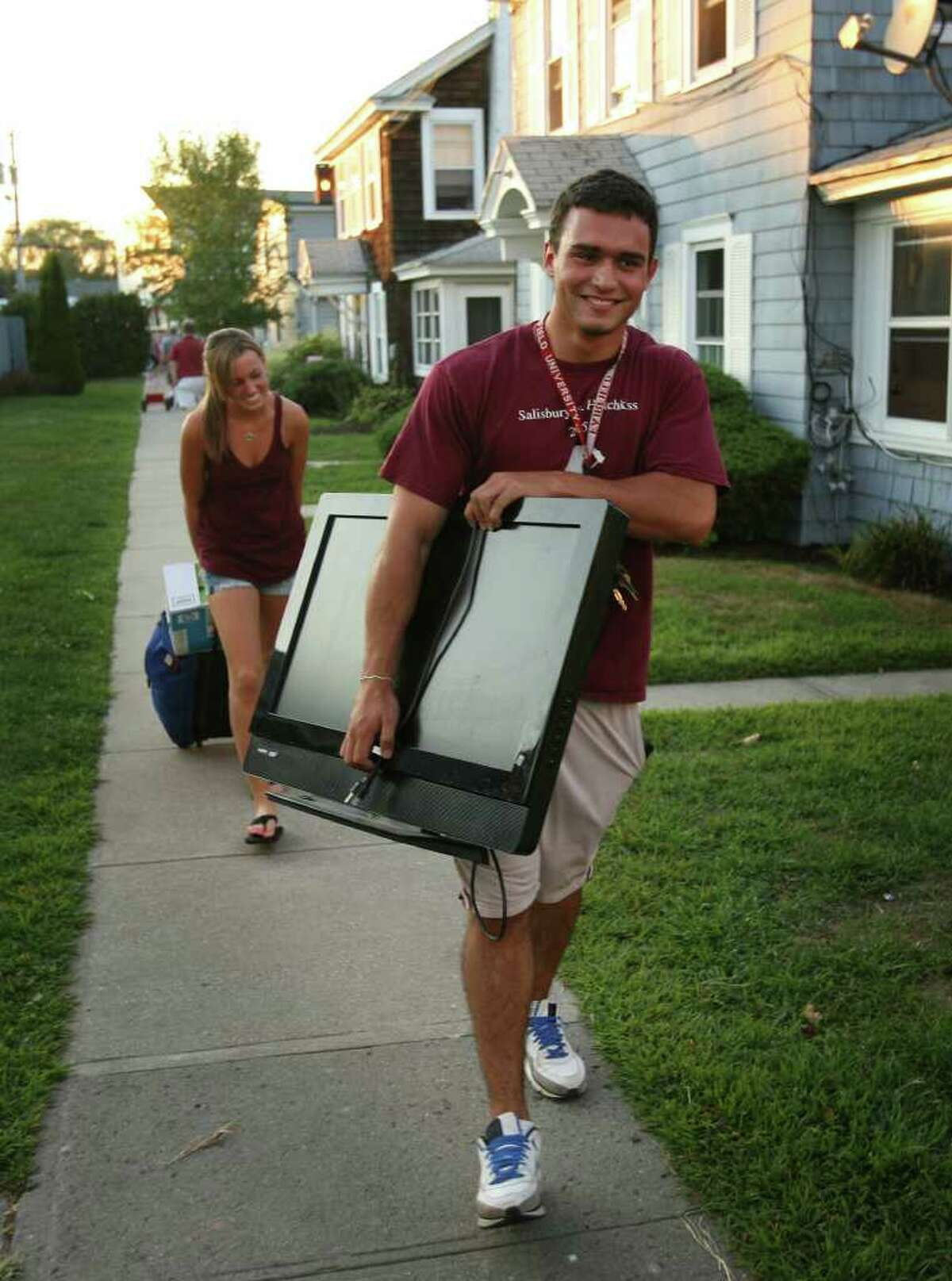 Fairfield University senior Mike Parent of Bethlehem, CT, carries his television to his rental house on Fairfield Beach on Monday, August 30, 2010.