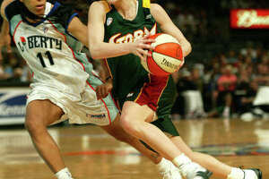 Seattle Storm guard Sue Bird drives around New York Liberty guard Teresa Weatherspoon in the first half at Madison Square Garden in New York, Tuesday, July 2, 2002.