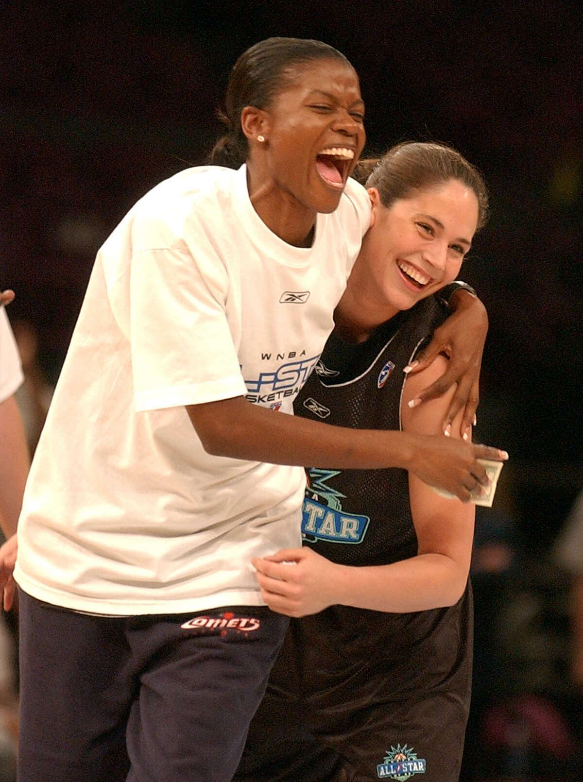 Western Conference All Stars Sheryl Swoopes, of the Houston Comets, hugs Sue Bird, of the Seattle Storm, after Bird sunk a basket from half court during practice for the WNBA All Star game at Madison Square Garden in New York, Friday, July 11, 2003.