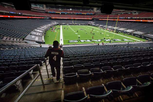 Houston Texans walk into the lower bowl of the stadium to watch warm ups before an NFL football game against the Jacksonville Jaguars at NRG Stadium on Sunday, Oct. 11, 2020, in Houston. Photo: Brett Coomer, Staff Photographer / © 2020 Houston Chronicle
