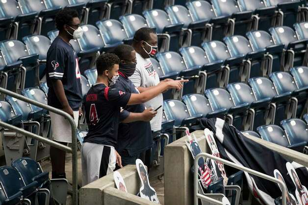 Houston Texans fans watch the teams warm up as the arrive to the stadium before an NFL football game against the Jacksonville Jaguars at NRG Stadium on Sunday, Oct. 11, 2020, in Houston. Photo: Brett Coomer, Staff Photographer / © 2020 Houston Chronicle