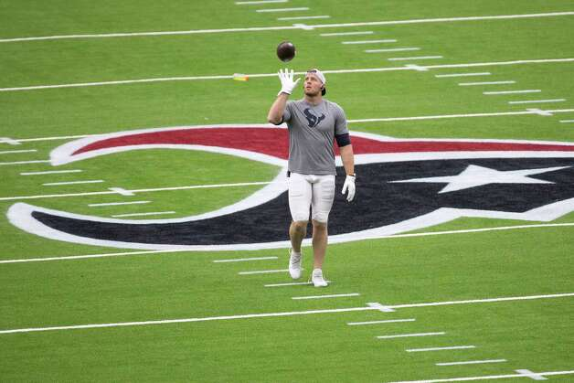 Houston Texans defensive end J.J. Watt tosses a football in the air while warming up before an NFL football game against the Jacksonville Jaguars at NRG Stadium on Sunday, Oct. 11, 2020, in Houston. Photo: Brett Coomer, Staff Photographer / © 2020 Houston Chronicle