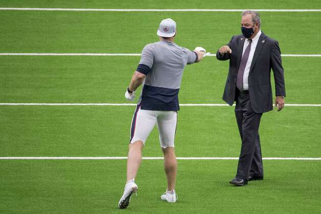 Houston Texans defensive end J.J. Watt, left, fist bumps with Cal McNair, chairman and CEO, while warming up before an NFL football game against the Jacksonville Jaguars at NRG Stadium on Sunday, Oct. 11, 2020, in Houston. Photo: Brett Coomer, Staff Photographer / © 2020 Houston Chronicle