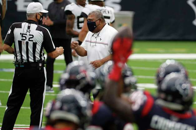 Houston Texans interim head coach Romeo Crennel greets referee Bill Vinovich (52) before an NFL football game at NRG Stadium on Sunday, Oct. 11, 2020, in Houston. Crennel takes over the Texans after former head coach Bill O'Brien was fired earlier in the week. Photo: Brett Coomer, Staff Photographer / © 2020 Houston Chronicle