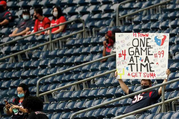 Houston Texans fans take their seats before an NFL football game against the Jacksonville Jaguars at NRG Stadium on Sunday, Oct. 11, 2020, in Houston. Photo: Brett Coomer, Staff Photographer / © 2020 Houston Chronicle