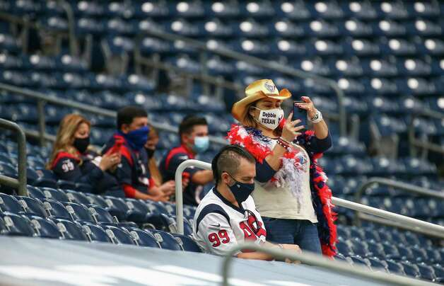 Houston Texans fans watch players warmup before an NFL game against the Jacksonville Jaguars at NRG Stadium on Sunday, Oct. 11, 2020, in Houston. Photo: Godofredo A. Vásquez, Staff Photographer / © 2020 Houston Chronicle
