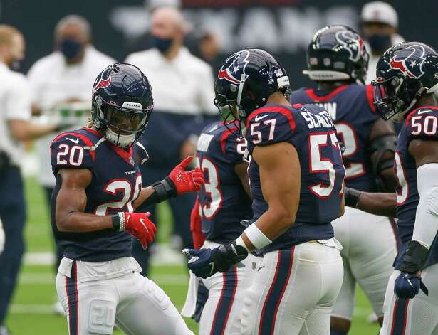 Houston Texans strong safety Justin Reid (20) and outside linebacker Brennan Scarlett (57) play air guitars during warmup, before the start of an NFL game against the Jacksonville Jaguars at NRG Stadium on Sunday, Oct. 11, 2020, in Houston. Photo: Godofredo A. Vásquez, Staff Photographer / © 2020 Houston Chronicle