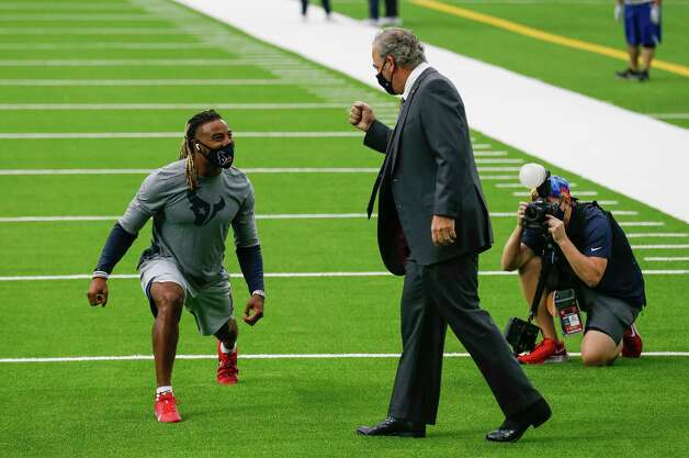 Houston Texans CEO Cal McNair says hi to strong safety Justin Reid (20) during warmup, before the NFL game against the Jacksonville Jaguars at NRG Stadium on Sunday, Oct. 11, 2020, in Houston. Photo: Godofredo A. Vásquez, Staff Photographer / © 2020 Houston Chronicle