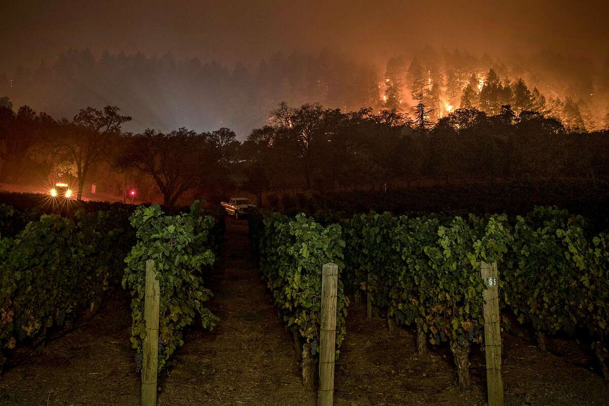 A fire crew keeps watch at Vineyard 29 as a slow moving section of the Glass fire continues to burn between St. Helena and Calistoga, Calif., on Monday, September 28, 2020.