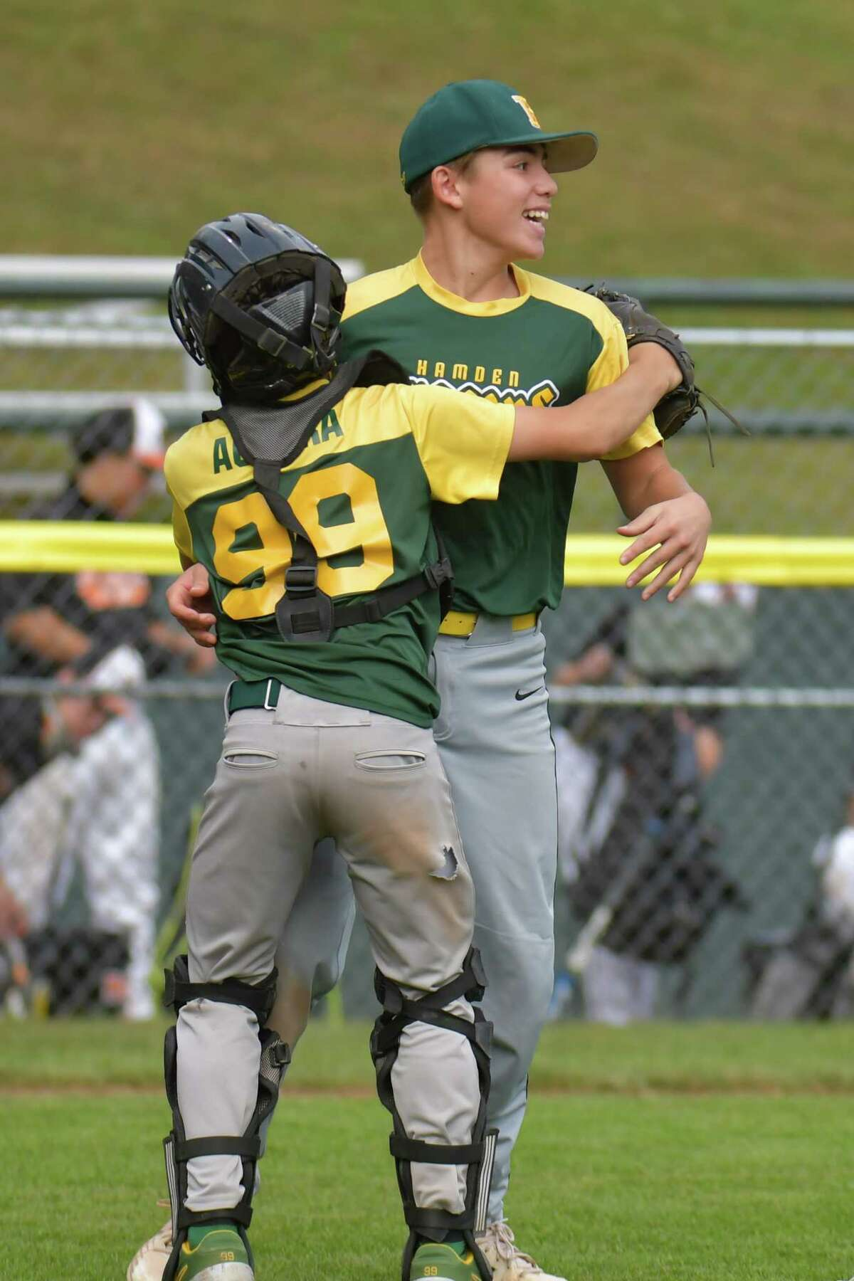 Pitcher Nate Marczak (18) of Hamden is congratulated by teammate AJ Aurora after winning the Connecticut Little League Championship on October 11, 2020 at Springdale Little League Field in Stamford, CT.