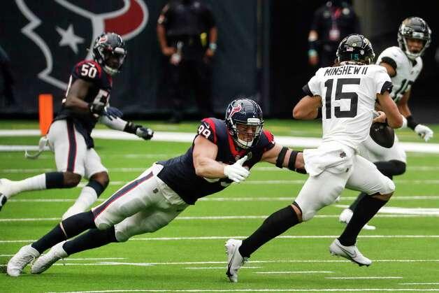 Houston Texans defensive end J.J. Watt (99) pressures Jacksonville Jaguars quarterback Gardner Minshew (15) during the first half of an NFL football game at NRG Stadium on Sunday, Oct. 11, 2020, in Houston. Photo: Brett Coomer, Staff Photographer / © 2020 Houston Chronicle