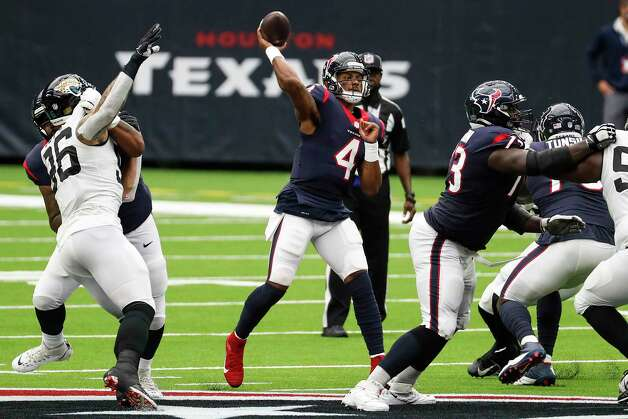Houston Texans quarterback Deshaun Watson (4) throws a 44-yard touchdown pass over the Jacksonville Jaguars defense to tight end Darren Fells during the first half of an NFL football game at NRG Stadium on Sunday, Oct. 11, 2020, in Houston. Photo: Brett Coomer, Staff Photographer / © 2020 Houston Chronicle