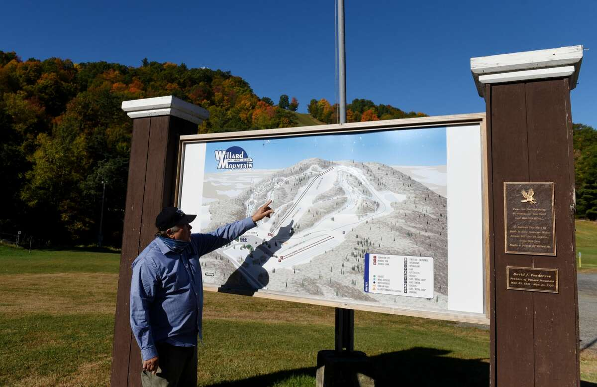 Chic Wilson, owner of Willard Mountain, points to a trail map of his ski resort on Friday, Oct. 9, 2020, in Greenwich, N.Y. Winter resorts are planning for the upcoming season. (Will Waldron/Times Union)