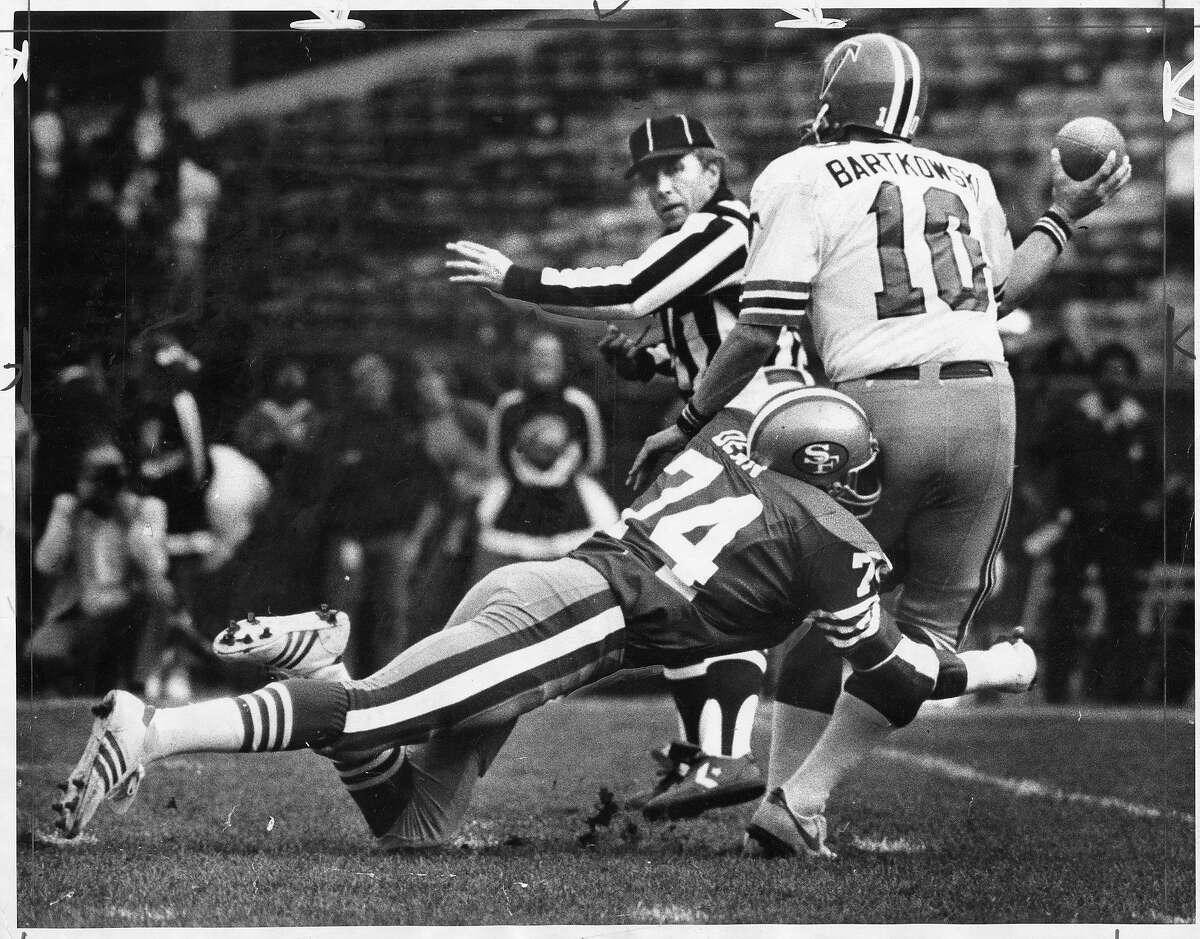 The San Francisco 49ers' Fred Dean tackles the Atlanta Falcons' Steve Bartkowski during a game on November 8, 1981.