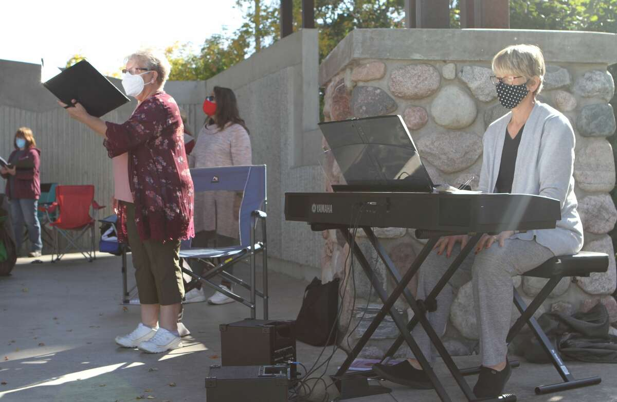 Members of Voca Lyrica, a local women's chorus, performed a variety of songs at the Bandshell in Hemlock Park.