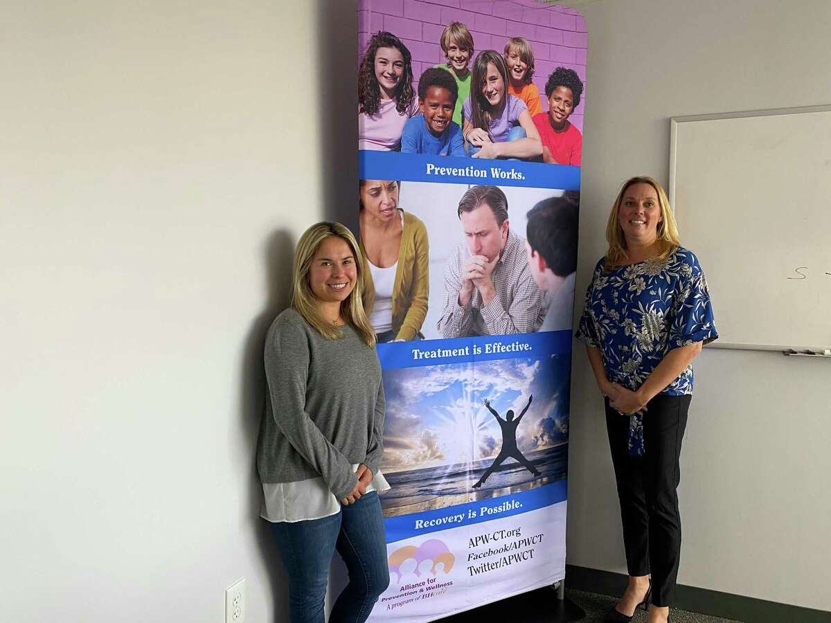 Anna Gasinski, prevention specialist, left, and Pam Mautte,division director for Alliance for Prevention and Wellness at BHcare, at the main BHcare office in North Haven.