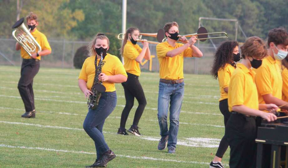 """The Manistee High School Marching Band performs its """"Guardian of the Galaxy"""" show before the homecoming game Friday. (Kyle Kotecki/News Advocate)"""