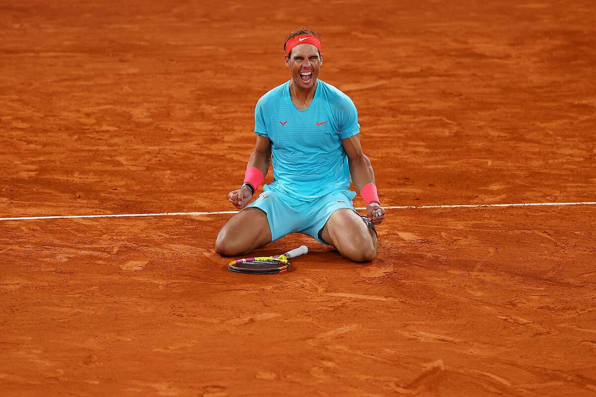 Rafael Nadal celebrates after beating Novak Djokovic at Roland Garros in Paris on Sunday. Nadal, 34, has won the French Open four years in a row and in 13 of the past 16 years.