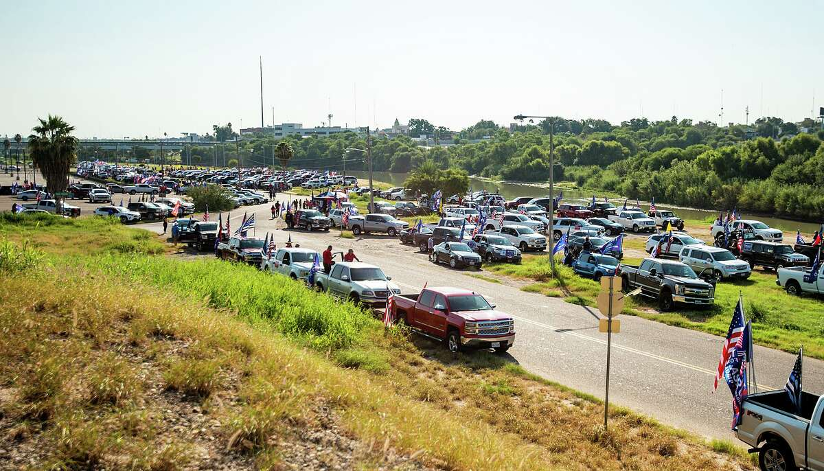 Supporters of President Trump gather at the banks of the Rio Grande, Saturday, Oct. 10, 2020, before departing for the second Trump Train through Laredo.