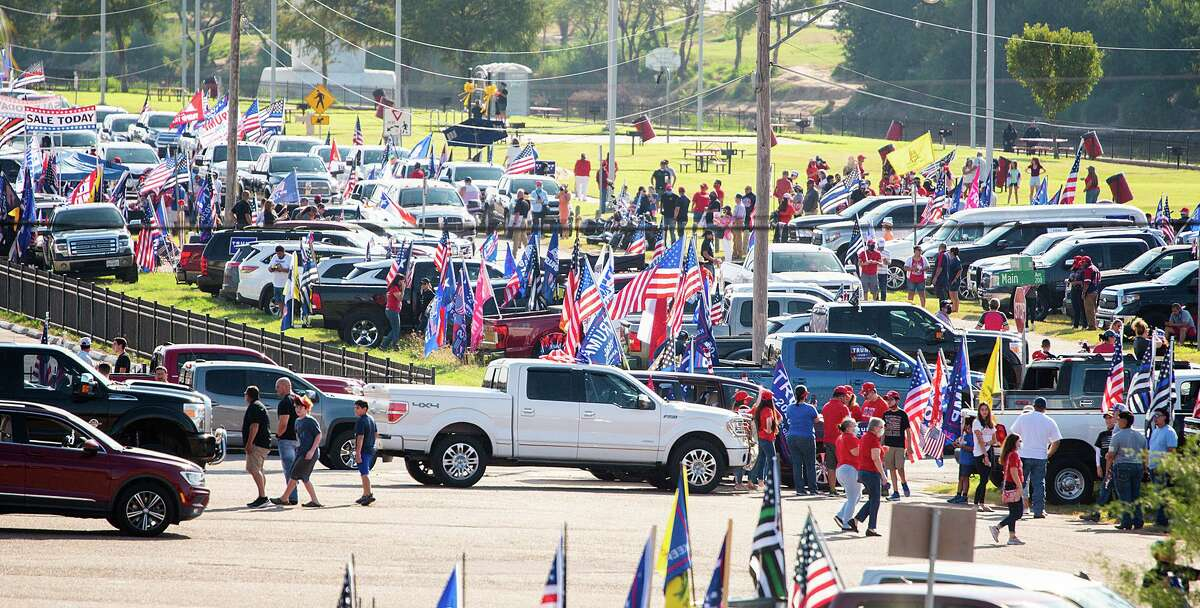 Supporters of President Trump gather at the banks of the Rio Grande, Saturday, Oct. 10, 2020, before departing for the second Trump Train through Laredo. Trump had increased support this election from Webb County.