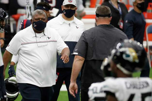 Houston Texans interim head coach Romeo Crennel, left meets Jacksonville Jaguars head coach Doug Marrone at midfield as time runs out in the Texans 30-14 win over the Jacksonville Jaguars in an NFL football game at NRG Stadium on Sunday, Oct. 11, 2020, in Houston. Photo: Brett Coomer, Staff Photographer / © 2020 Houston Chronicle