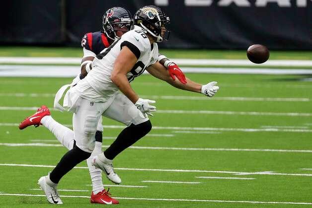 Houston Texans cornerback Lonnie Johnson (32) breaks up a pass intended for Jacksonville Jaguars tight end Tyler Eifert (88) during the fourth quarter of an NFL football game at NRG Stadium on Sunday, Oct. 11, 2020, in Houston. Photo: Brett Coomer, Staff Photographer / © 2020 Houston Chronicle