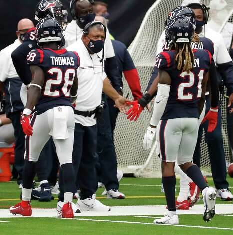 Houston Texans interim head coach Romeo Crennel high fives his defense after stopping the Jacksonville Jaguars during the fourth quarter of an NFL football game at NRG Stadium on Sunday, Oct. 11, 2020, in Houston. Photo: Brett Coomer, Staff Photographer / © 2020 Houston Chronicle