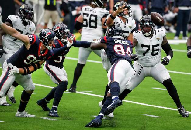 Houston Texans defensive end Charles Omenihu (94) hits Jacksonville Jaguars quarterback Gardner Minshew (15) as he releases the ball for an incomplete pass during the fourth quarter of an NFL football game at NRG Stadium on Sunday, Oct. 11, 2020, in Houston. Photo: Brett Coomer, Staff Photographer / © 2020 Houston Chronicle