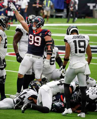 Houston Texans defensive end J.J. Watt (99) signals that the Texans had recovered a Jacksonville Jaguars fumble for a turnover during the fourth quarter of an NFL football game at NRG Stadium on Sunday, Oct. 11, 2020, in Houston. Photo: Brett Coomer, Staff Photographer / © 2020 Houston Chronicle